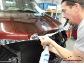 Professional Clear Bra Installation in Aspen-Basalt Area technician precisely follows hood contours