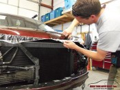 Professional Clear Bra Installation in Aspen-Basalt Area technician removes excess clear bra protective film