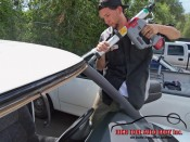 setting adhesive to the windshield frame