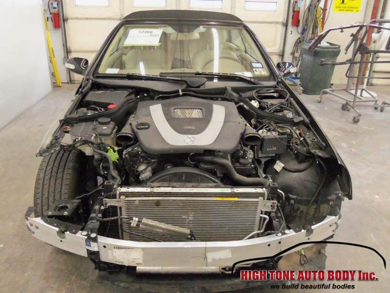 Stripped of all damaged and removable panels, this Mercedes awaits engine removal