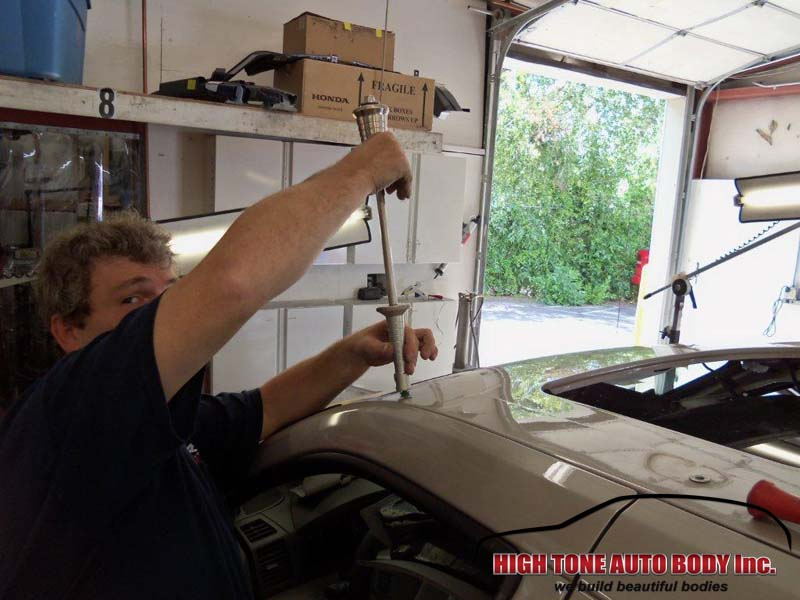 Removing dents without any auto body work for a quick and affordable auto body repair