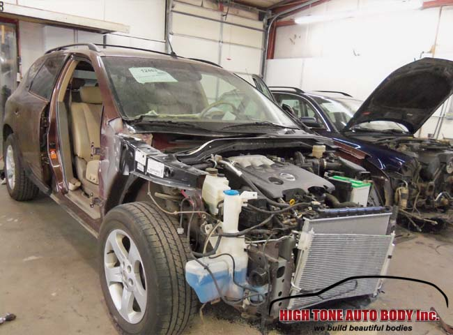 Auto body repairs done, the Nissan awaits panel replacement phase