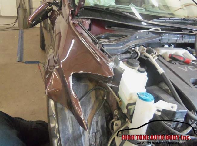 frontal collision caused significant damage to this SUV
