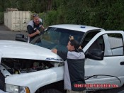 positioning the windshield on the pickup truck
