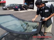 de-greasing the new windshield before priming it