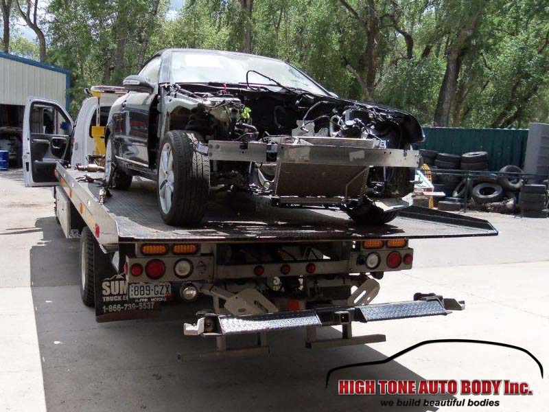 A sublet car repair shop removed the engine and the Mercedes is ready for auto body repair