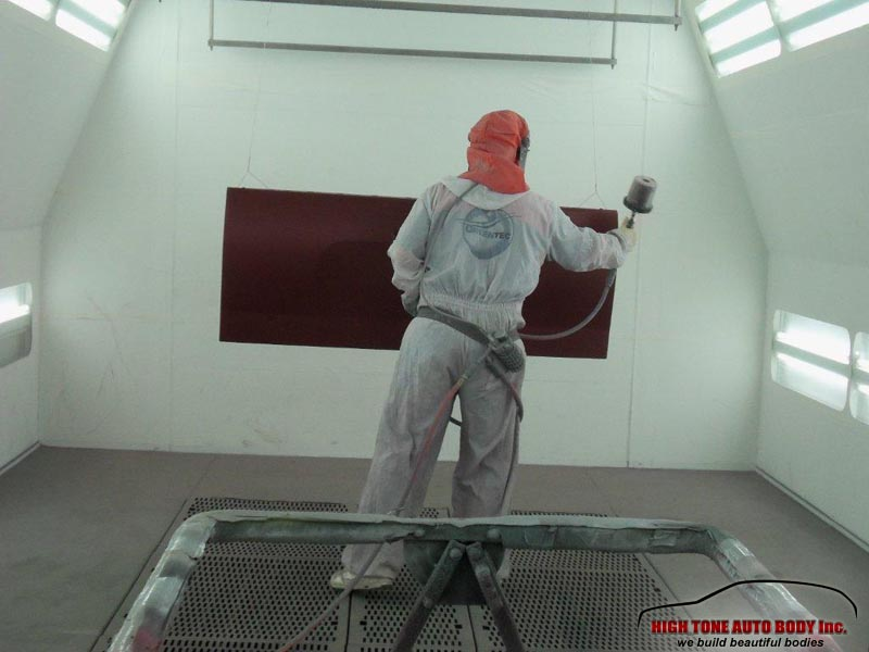 painting a crashed car with deep cherry red